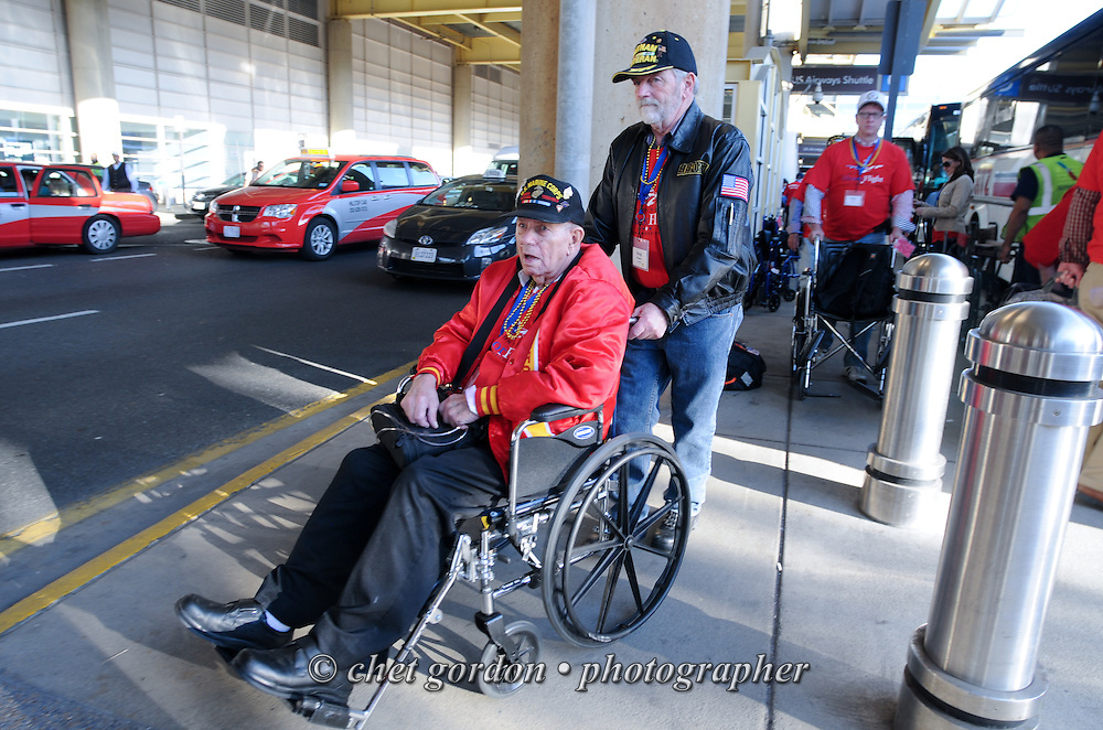 WWII Veterans and their escorts onboard the Hudson Valley Honor Flight depart Reagan National Airport in Arlington, VA on Saturday, April 11, 2015. Nearly 100 Veterans from the Orange County (NY) region toured the WWII, Korean, Vietnam, and USMC War Memorials, as well as Arlington National Cemetery. Hudson Valley Honor Flight is a chapter of the Honor Flight Network, which provides free flights for WWII Veterans and tours of the WWII Memorial constructed in their honor, and other sites in the nation's capital.  © Chet Gordon for Hudson Valley Honor Flight