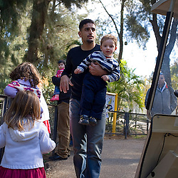 Israeli soccer star Abbas Suan, holds his son Mohammad, 2, during an outing to the zoo with family members, Ramat Gan, Israel, Jan. 31, 2006. Suan, an Israeli-Arab, still faces criticism and racism resulting from the unsettled conflict between the Israelis and Palestinians.