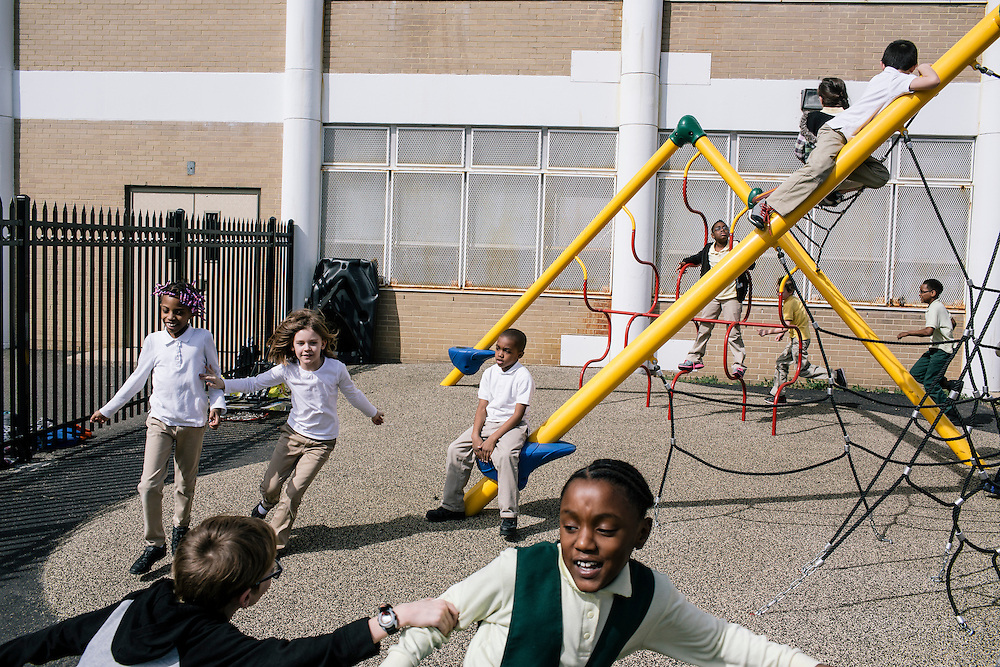 Students play tag and climb on playground equipment during recess at Leckie Elementary School on March 16, 2015.