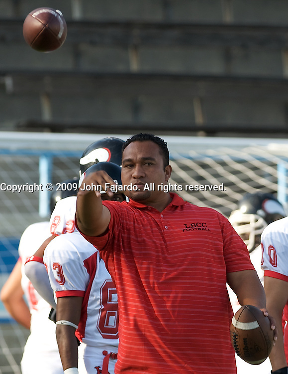 LBCC assistant coach Neo Aoga throws a pass before the non-conference game against El Camino College at Murdock Stadium, Torrance CA, Saturday, Sep. 12, 2009.