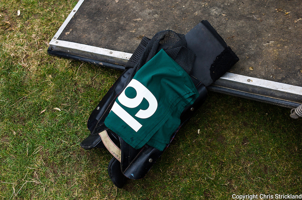 A racing saddle on a horse trailers ramp.