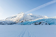 Cross-country ski trails on Portage Lake lead to Portage Glacier in Chugach National Forest in Southcentral Alaska. Morning. Spring.