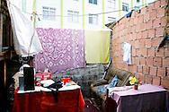 Jacarézinho favela, North Zone of Rio. Place of prostitution for crack junkies and their customers. Butter replaces the lubricant. Sex coasts less than one euro, as evidenced by the accounting left on the table, in the urgency of the flee from the arrival of the police. Military police and social workers of the City looking for crack users in the early morning to take them to a selection center. Minors will be directed to detention rehab centers. // Favela Jacarézinho, Zona Norte de Rio. Lieu de passes pour camés au crack et leurs clients. Le beurre fait office de lubrifiant. La passe est à moins d'un euro, comme en atteste la comptabilité laissé sur la table, dans l'urgence de la fuite face à l'arrivée de la police.. La police militaire et les assistants sociaux de la Mairie recherchent les usagers de crack au petit matin, pour les emmener dans un centre de tri. Les mineurs seront dirigés vers des centres fermés.