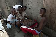 Boys from Shada enjoy a game of checkers. Cap Haitian, Haiti, January 28, 2008.