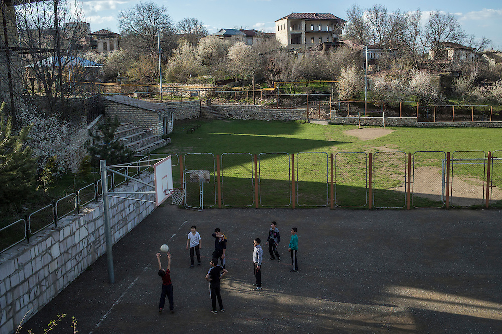 SHUSHI, NAGORNO-KARABAKH - APRIL 18: Boys play on a basketball court on April 18, 2015 in Shushi, Nagorno-Karabakh. Since signing a ceasefire in a war with Azerbaijan in 1994, Nagorno-Karabakh, officially part of Azerbaijan, has functioned as a self-declared independent republic and de facto part of Armenia, with hostilities along the line of contact between Nagorno-Karabakh and Azerbaijan occasionally flaring up and causing casualties. (Photo by Brendan Hoffman/Getty Images) *** Local Caption ***