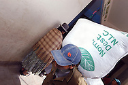 n heavy bag of coca leaving Villa Fatima's market job, work, agriculture, woman, traditional hat, market, Villa Fatima