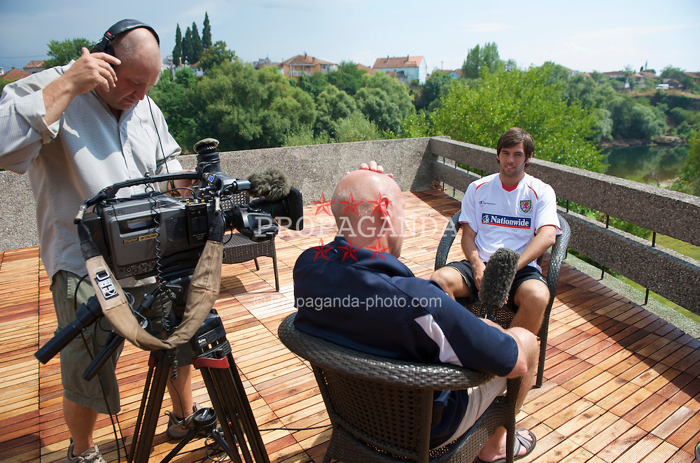 PODGORICA, MONTENEGRO - Tuesday, August 11, 2009: Wales' captain Joe Ledley during a BBC television interview at the Podgorica Hotel ahead of the international friendly match against Montenegro. (Photo by David Rawcliffe/Propaganda)