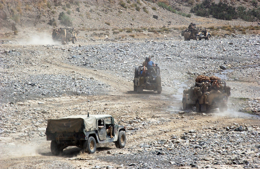 British marine commandos move by convoy across a dry riverbed during Operation Buzzard June 18, 2002 in southeastern Afghanistan. Britain is expected to begin withdrawing its 1,700 troops currently deployed in Afghanistan by the end of June 2002.
