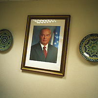 A framed photograph of President of Uzbekistan, Ismail Karimov, hangs in a hotel lobby. Tashkent, Uzbekistan