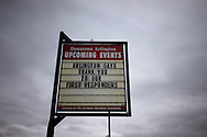 A sign referring to emergency personnel responding the nearby mudslide is seen in downtown Arlington, Washington March 28, 2014.  Rescue officials said the death toll from a catastrophic mudslide in Washington state is soon expected to climb far higher, as some residents voiced anger that they were prevented from helping in the initial disaster response six days ago.   REUTERS/Rick Wilking (UNITED STATES)