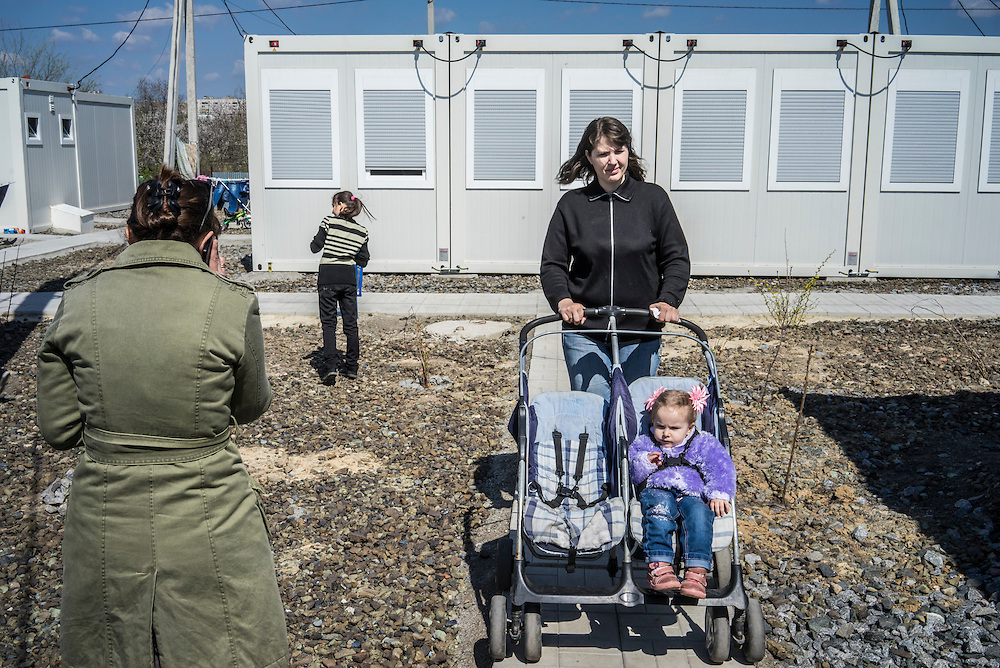 Residents of a cluster of prefabricated container houses known as Transit City on Monday, April 27, 2015 in Kharkiv, Ukraine. The spot is home to 83 families, and 387 people total, who are IDPs forced to flee eastern Ukraine because of fighting between Ukrainian forces and pro-Russian rebels. CREDIT: Brendan Hoffman/Prime for the Wall Street Journal UKRMIGRATION