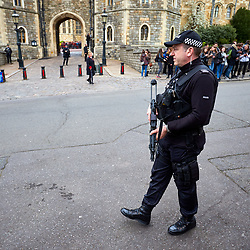 © Licensed to London News Pictures. 29/03/2017. WINDSOR, UK.  The Changing of the Guard ceremony takes places at Windsor Castle amid heightened security. Heavy barriers have been installed along the parade route and armed police officers are present.   Photo credit: Cliff Hide/LNP