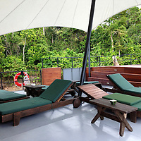 South America, Peru, Amazon. Deck and Jacuzzi on the M/V Aria by Aqua Expeditions.