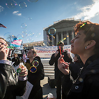 Shadoe Williamson, left, of Austin, TX and Vanessa Long, right, of Miami, FL, blow bubbles during a marriage equality rally at the US Supreme Court while arguments on legalizing same-sex marriage is heard in Washington D.C. March 27, 2013. The US Supreme Court is considering the issue of legalizing same-sex marriage, during oral arguments on DOMA. Photo Ken Cedeno
