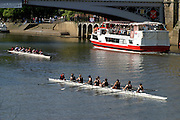 Tourists boat cruise and rowing eight on the river Ouse in York.