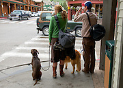 Study in similarities. Two people, two dogs, two drinks, two backpacks, Two...Act in unison.  Jackson Hole, Wyoming.