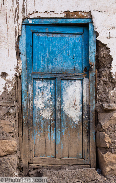 Weathered blue door in Llamac village. Day 9 of 9 days trekking around the Cordillera Huayhuash in the Andes Mountains, Peru, South America.