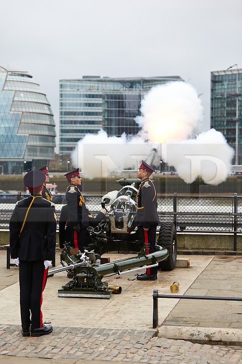© Licensed to London News Pictures.  17/04/2013. LONDON, UK. Members of the Honourable Artillery Company fire a gun salute at the Tower of London during the funeral of former Prime Minster Margaret Thatcher. The guns were fired every minute while the coffin was making its way to St Paul's Cathedral. Photo credit: Cliff Hide/LNP