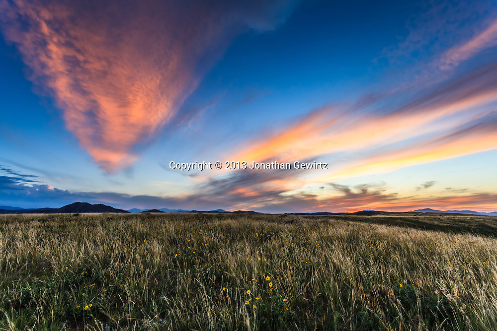 A beautiful Colorado sunset as seen from the William F. Hayden Park on Green Mountain in Lakewood. <br /> <br /> WATERMARKS WILL NOT APPEAR ON PRINTS OR LICENSED IMAGES.<br /> <br /> Licensing: https://tandemstock.com/assets/18622195