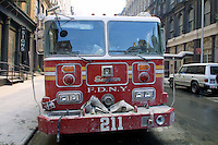 13 September 2001: Engine 211 fire truck is covered by ashes filled with human remains after the Terrorist attack on the America's.  Lower Manhattan, NY. Area surrounding ground zero where the World Trade Centers WTC once stood only hours after they fell to the ground in New York.  Islamic terrorist Osama bin Laden declares The Jihad or Holy War against The United States of America on September 11, 2001. Headline news photos available for editorial use.