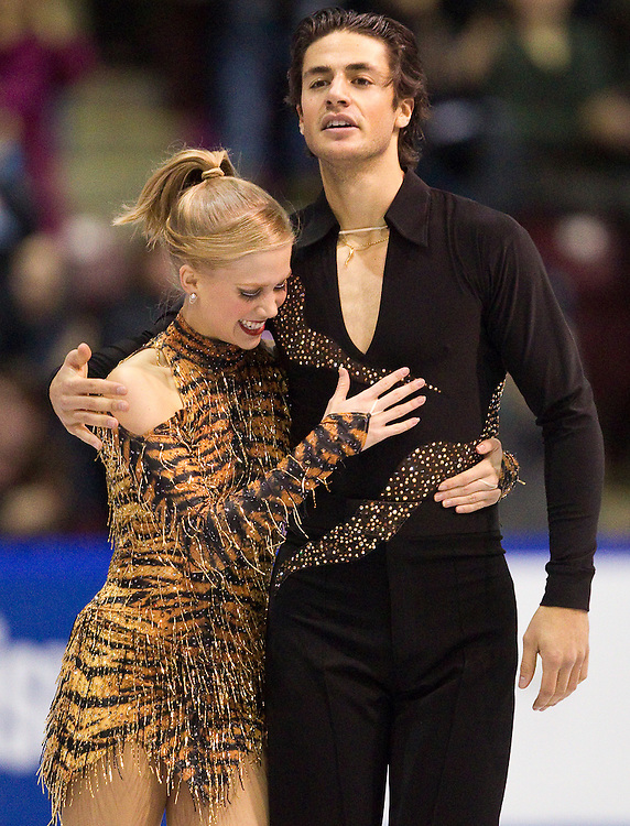 GJR372 -20111028- Mississauga, Ontario,Canada-  Kaitlyn Weaver  and Andrew Poje of Canada celebrate after their short program at Skate Canada International, in Mississauga Ontario, October 28, 2011.<br /> AFP PHOTO/Geoff Robins