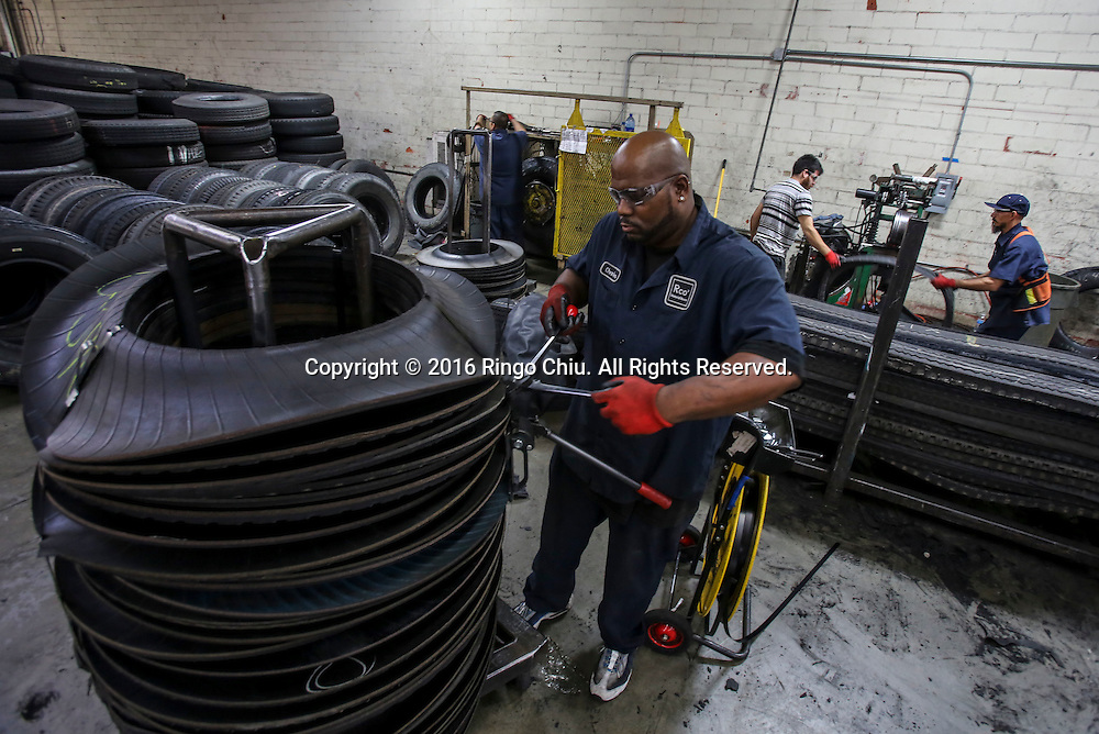 RCO Material Reuse, a factory cuts and molds tires into new products such loading dock bumpers and parking barriers.<br /> (Photo by Ringo Chiu/PHOTOFORMULA.com)<br /> <br /> Usage Notes: This content is intended for editorial use only. For other uses, additional clearances may be required.