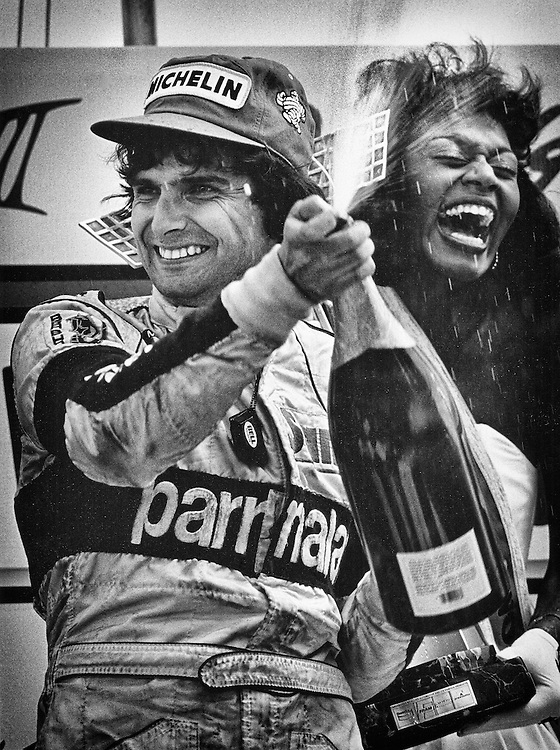 Two-time Brazilian World Driving Champion Nelson Piquet celebrates his victory in the 1984 Detroit Grand Prix driving the Parmalat- MRD-Brabham-BMW BT53. <br />
