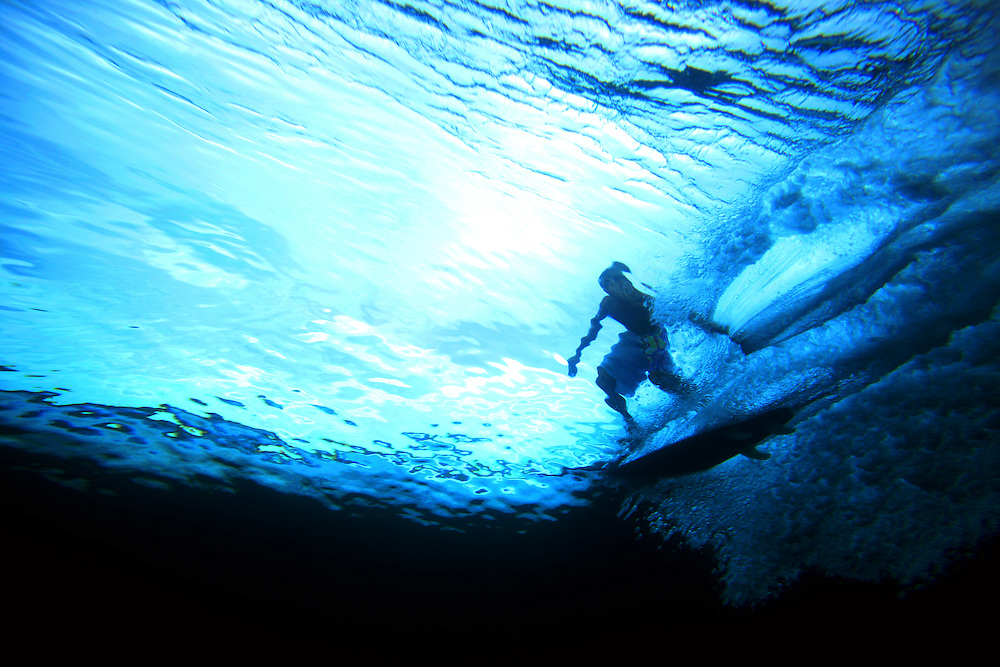 Surfing tropical waves underwater view