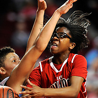 Paul Laurence Dunbar's Jordin Fender (2) drives to the basket with Boone County's Sydney Moss defending in a high school basketball game Wednesday, March 7, 2012, during the KHSAA Girls' Sweet 16 State Basketball Tournament at Diddle Arena in Bowling Green, Ky (AP Photo/Daily News, Joe Imel)