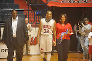 "Ole Miss guard Zach Graham (32) with his family and Ole Miss head coach Andy Kennedy against Arkansas on Senior Day at C.M. ""Tad"" Smith in Oxford, Miss. on Saturday, March 5, 2010. Ole Miss won 84-74."