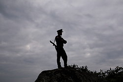 Mai Ja Yang 20160912<br /> A K.I.A. rebell looks out over one of their outposts near Mai Ja Yang in Kachin State, Myanmar.<br /> Photo: Vilhelm Stokstad / Kontinent