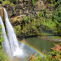 Wailua Falls with Rainbow near Līhu&rsquo;e on Kaua&rsquo;i, Hawaii<br /> Remember in the Fantasy Island TV show when Tattoo would ring a bell and shout, &ldquo;Da Plane! Da Plane!&rdquo;  Part of those opening credits featured Wailu Falls on the island of Kaua&rsquo;i, Hawaii.  These twin streams cascade 80 feet into a basin and create splendid rainbows that dance among the rising mist.  Ironically, after the show was cancelled, that plane was seized in a raid of cocaine smugglers.