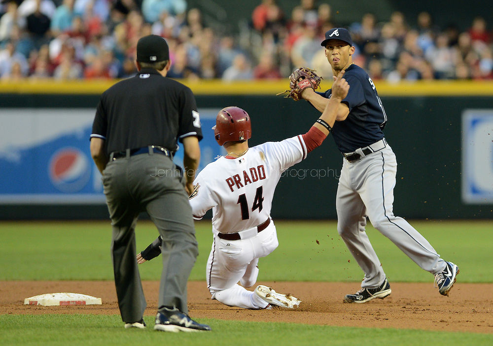 May 14, 2013; Phoenix, AZ, USA; Atlanta Braves infielder Andrelton Simmons (19)  gets the force out as the Arizona Diamondbacks infielder Martin Prado (14) slides into second base in the second inning at Chase Field. The Diamondbacks defeated the Braves 2-0. Mandatory Credit: Jennifer Stewart-USA TODAY Sports