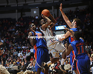 Mississippi's Chris Warren (12) shoots  vs. Florida's Vernon Macklin (32) and Dan Werner defend at the Tad Smith Coliseum in Oxford, Miss. on Saturday, February 20, 2010 in Oxford, Miss. Florida won 64-61.