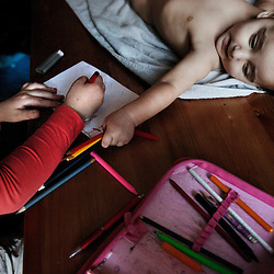 Veronika Sindel&aacute;rov&aacute;'s youngest child, Fabi&aacute;n Gina, 1, plays with the school supplies of relative Vanesa Sindel&aacute;rov&aacute;, 8, in their home in Ostrava, Czech Republic on Feb. 27, 2012. Veronika was one of 18 Roma children who were represented in the D.H. and Others v. Czech Republic case, the first challenge to systemic racial segregation in education to reach the European Court of Human Rights.<br /> When this case was first brought in 2000, Roma children in the Czech Republic were 27 times more likely to be placed in &quot;special schools,&quot; intended for the mentally disabled, than non-Roma children. In 2007, the Grand Chamber of the European Court of Human Rights ruled that this pattern of segregation violated nondiscrimination protections in the European Convention on Human Rights. Despite this landmark decision, little change has occurred: the &quot;special schools&quot; have been renamed but follow the same substandard curriculum and Roma continue to be assigned to these schools in disproportionate numbers. The process of integration has barely begun.