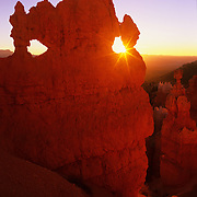 The Mask, one of the most recognizable hoodoos in Bryce Canyon National Park, glows in the early morning light. - Utah.