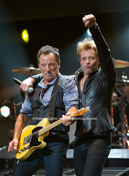 Jon Bon Jovi and Bruce Springsteen & the E Street Band perform at the 12-12-12 fundraising concert to aid the victims of Hurricane Sandy, will take place on December 12, 2012 at Madison Square Garden. The concert featured The Rolling Stones, Bon Jovi, Eric Clapton, Dave Grohl, Billy Joel, Alicia Keys, Chris Martin, Bruce Springsteen & the E Street Band, Eddie Vedder, Roger Waters, Kanye West, The Who, and Paul McCartney. All the proceeds went go to the Robin Hood Relief Fund. Robin Hood, the largest independent poverty fighting organization in the New York area, will insure that every cent raised will go to non-profit groups that are helping the tens of thousands.of people throughout the tri-state area who have been affected by Hurricane Sandy...Photo © Robert Caplin..
