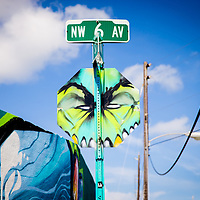 MIAMI, FLORIDA -- July 11, 2015 -- People check out the old warehouses, public art, and studios during the colorful and vibrant Art Walk in the Wynwood Art District Miami, Florida.  The event on the second Saturday of every month features not only public art, but gallery tours, dining at a myriad of restaurant and a party atmosphere after dark.  (PHOTO / CHIP LITHERLAND)