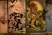 """A decorative screen with scenes from the novel """"The Tale of Genji"""", exhibited at Ishiyamadera Temple as part of the 1000 years since it was written celebrations..."""