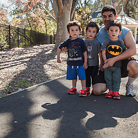 "Winery truck driver Agustin Cendejar with his three two-year old sons Leo, Jullian and Sandro in Calistoga.  ""I work nights and my wife works days...we have our hands full.""  agustin.cendejar@jfwmail.com"