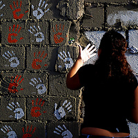 VENEZUELAN POLITICS / POLITICA EN VENEZUELA<br /> Students place their hands on the walls of the process against President Hugo Chavez / Estudiantes colocan sus manos en paredes en contra del proceso del Presidente Hugo Chavez<br /> Caracas - Venezuela 2009<br /> (Copyright &copy; Aaron Sosa)