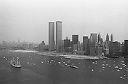 1976, Manhattan, New York City, New York State, USA --- Dozens of boats including a tall ship parade in New York Harbor for the 1976 Bicentennial celebration. --- Image by © Owen Franken/CORBIS
