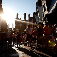 ORLANDO, FL -- May 30, 2010 -- Harry Potter fans sprint through the street to get to the new Harry Potter and the Forbidden Journey ride at The Wizarding World of Harry Potter at Universal Orlando in Orlando, Fla., on Sunday, May 30, 2010.  The 20-acre park features a new ride inside the Hogwarts Castle, shops along the village of Hogsmeade, and is scheduled to officially open on June 18.