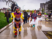 01 MAY 2017 - ST. PAUL, MN: Nahuatl dancers lead a May Day immigrants' rights march around the Minnesota State Capitol. About 300 people, representing immigrants' and workers' rights organizations, marched through the Minnesota State Capitol during a demonstration to mark May Day, International Workers' Day.      PHOTO BY JACK KURTZ