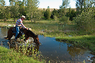 Trail Rider crosses water, Montana, <br /> MODEL RELEASED, PROPERTY RELEASED
