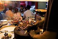 serving kueh chap along Kuching's Carpenter Street