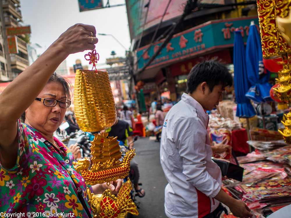 "04 FEBRUARY 2016 - BANGKOK, THAILAND: People shop for Chinese New Year supplies in Bangkok's Chinatown district, before the celebration of the Lunar New Year. Chinese New Year, also called Lunar New Year or Tet (in Vietnamese communities) starts Monday February 8. The coming year will be the ""Year of the Monkey."" Thailand has the largest overseas Chinese population in the world; about 14 percent of Thais are of Chinese ancestry and some Chinese holidays, especially Chinese New Year, are widely celebrated in Thailand.      PHOTO BY JACK KURTZ"