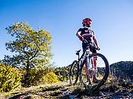 Mountain Bike rider looking the landscape in Catalonia (Spain)