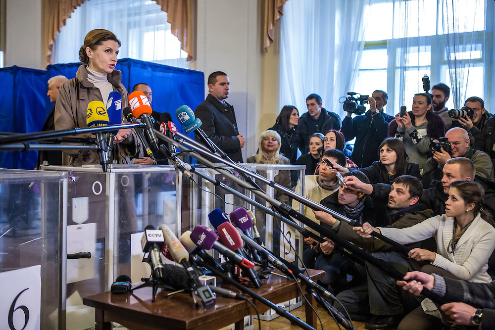 KIEV, UKRAINE - OCTOBER 26: Maryna Poroshenko, wife of President Petro Poroshenko, speaks to journalists after casting her ballot in parliamentary elections on October 26, 2014 in Kiev, Ukraine. Although a low turnout is expected in the east of the country amid continued fighting between Ukrainian forces and pro-Russian separatists, Ukraine is expected to elect a pro-Western parliament in a further move away from Russian influence. (Photo by Brendan Hoffman/Getty Images) *** Local Caption *** Maryna Poroshenko