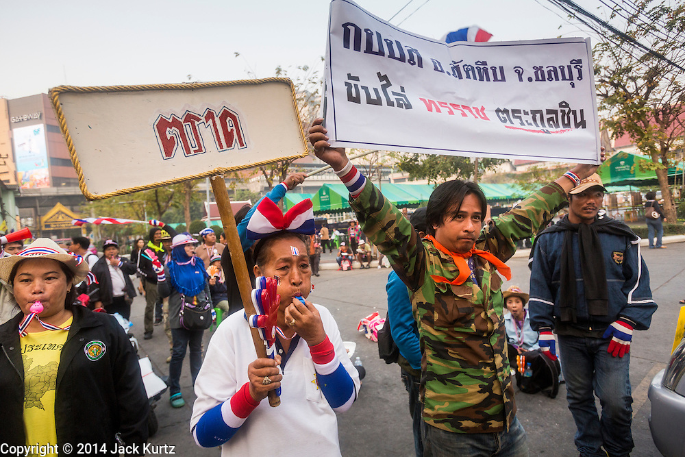 26 JANUARY 2014 - BANGKOK, THAILAND:   Anti-government protestors block access to the polling places at Wat That Thong in Bangkok. Anti-government protestors forced the closure of polling places in Bangkok Sunday as a part of Shutdown Bangkok. Protestors blocked access to gates and entry ways to polling places and election officials chose the close them rather than confront protestors. Early voting was supposed to be Sunday January 26 but blocked polling places left hundreds of thousands of people unable to vote casting the February 2 general election into doubt and further gridlocking Thai politics. Shutdown Bangkok has been going for 12 days with no resolution in sight. Suthep, the leader of the anti-government protests and the People's Democratic Reform Committee (PDRC), the umbrella organization of the protests,  is still demanding the caretaker government of Prime Minister Yingluck Shinawatra resign, the PM says she won't resign and intends to go ahead with the election.  PHOTO BY JACK KURTZ